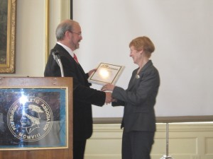 Joan receiving award